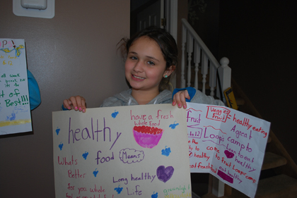 Danika Bellissimo, 11, holds her healthy food messages from the March break Fruit Loops Kids Camp.
