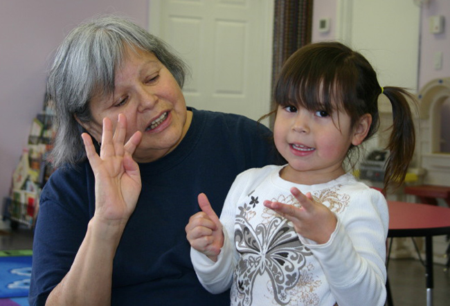 Language instructor Roseanne Monague helps Ava Love-Assance learn how to count in Anishinaabemowin.