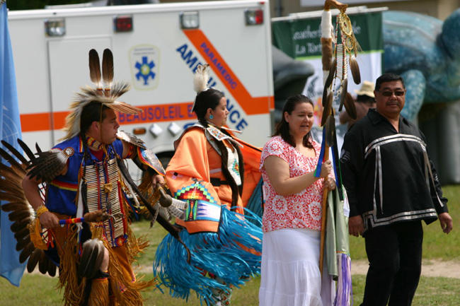 Grand Entry, featuring dancers Clayton King and Nicki Monague with Christian Island Elementary School principal Angela Johnson and Beausoleil First Nation Chief Roly Monague.