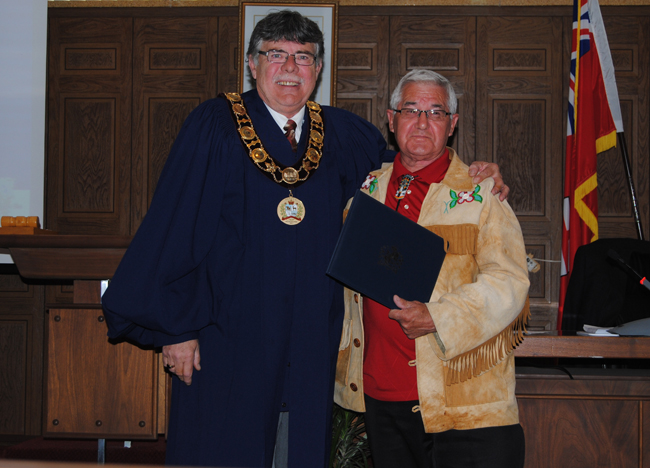 Curve Lake First Nation Councillor Keith Knott received a Certificate of Recognition Award from Warden, J. Murray Jones during the Peterborough County Council meeting for his years of dedicated service to his community and local region.