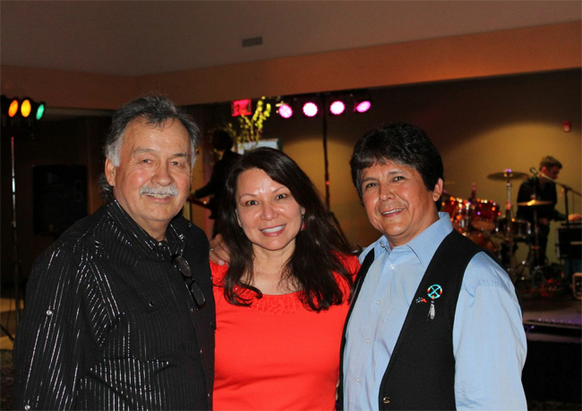 Reggie Leach (former NHLer) and Waubetek General Manager Dawn Madahbee with Chief Clarence Louie of Osoyoos First Nation.