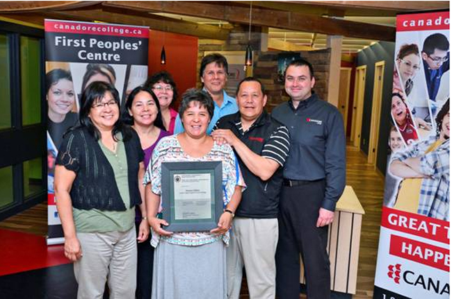 Celebrating Annette Chiblow's success are, from left,: Judy Manitowabi, Manager of Community-Based Training; Paulette Aiabens, Registrar Liaison; Liz Dowdall, Counsellor; Annette Chiblow; Gerard Peltier, Recruiting Officer; Roger Chum, Counsellor; Shawn Chorney, Vice-President of Student Services.