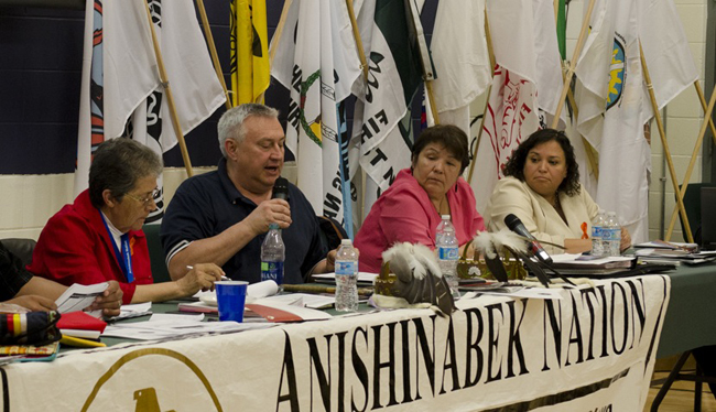 An Education Panel discusses the strategic plan for the Anishinabek Education System at the 2013 Grand Council Assembly. L-R: Chief Marianna Couchie, Robert Beaudin, M'Chigeeng First Nation , Sharon Goulais, Dokis First Nation, Tracy O'Donnell, UOI Education Negotiator.     – Photo by Monica Lister.