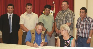 Signing of the Hydromega/Okikendawt Hydro Project partnership in June 2012, from left, Hydromega representative Stephan Boyer with Dokis First Nation councillors Gerry Duquette, Derek Restoule, Chris Dokis and Roger Restoule. Front: The late Leonard Dokis (Councillor) and Chief Denise Restoule.    – Photo by Marci Becking