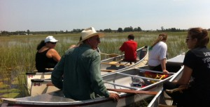 Jeff Beaver, citizen of Alderville First Nation with Mississaugas of Scugog youth in the wild rice beds of Mitchell Bay.