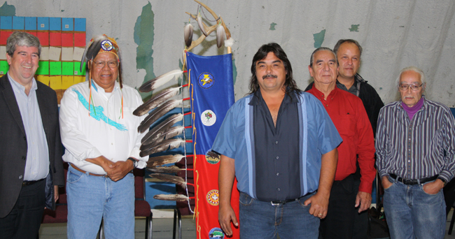 Participants at a ceremony for the twinning of Highway 69 included, from left: Ontario Minister of Transportation Glen Murray, Shawanaga First Nation Chief Wayne Pamajewon,  Henvey Inlet FN Chief Wayne McQuabbie, Magnetawan FN Chief William Diabo,  Wasauksing FN Chief Warren Tabobondung and Eastern Doorway Chief of the Three Fires Midewiwin Lodge Jim Dumont.