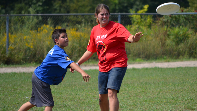 Lakeview Grade 5 student Kacey Debassige displays his Frisbee throwing form, while Grade 5 teacher Meagan Middelton, gets ready to catch the next approaching disc.      – Photo by Hiba Alvi