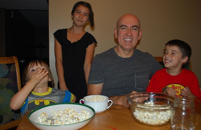 Nova, Sarita, Fred and Kiigin Bellefeuille enjoy some air-popped popcorn.