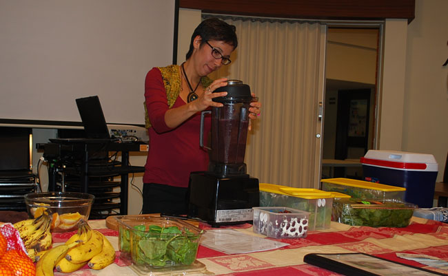 Sarah Blackwell makes green smoothies.  – Photo by Jared McLeod