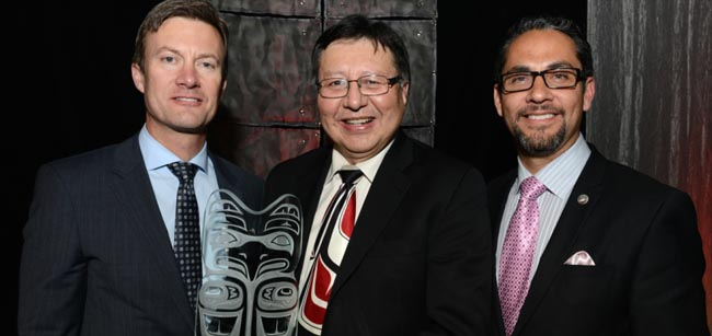 Dean Johnson, left, president of Sodexo Canada presents  first AEDC award to Dan Christmas, special advisor for Membertou First Nation. At right is JP Gladu, CEO and president of Canadian Council for Aboriginal Business.   – Photo courtesy CCAB