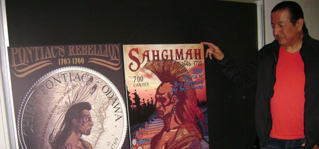 Artist Philip Cote in Toronto with his posters of Ottawa warriors Pontiac and Sahgimah.