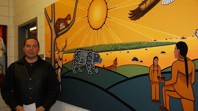 Beausoleil First Nation artist Clayton King with his painting 'Openikaaning'.