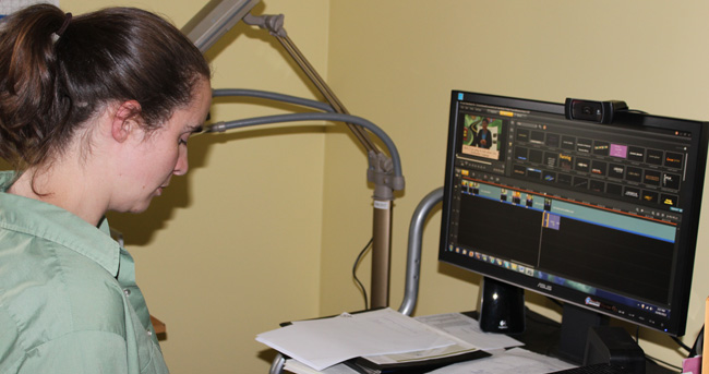 Gloria Burns, citizen of Garden River First Nation, works with video editing software.