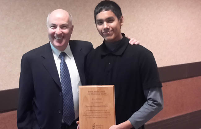 David Lindsay, President and CEO of the Forest Products Association of Canada (FPAC) presents the third annual Youth Skills Award for Aboriginal Youth to Shownoo Blackbird-Williams on December 10th. The $2,500 award is targeted at youth ages 18 to 30 who are enrolled in an apprenticeship program, college or in university, who are a First Nations, Métis or Inuit individual with strong academic standing, and who are committed to their field of study and a career in the revitalized forest sector. Blackbird-Williams is enrolled in the First Nations Forestry Technician Program at the Anishinabek Educational Institute at Munsee-Delaware Campus, associated with Fleming College in London, ON.
