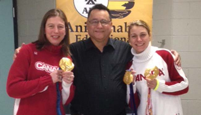 Olympic hockey gold medalists Becky Kellar and Cheryl Pounder with Anishinabek Nation Grand Council Chief Patrick Madahbee at the Little NHL tournament in Mississauga.   – Photo by Melissa Seamont