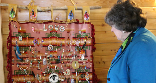 Law Society of Upper Canada treasurer Janet Minor admires the artwork of earrings placed so far on the 'Blanket of Hope' honouring the murdered and missing Indigenous women in Canada.