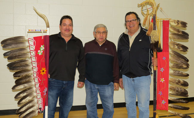 Chief Chris Plain with Aamjiwnaang's new Eagle Staff, Elder Ted White Sr. and former Chief Phillip Maness holds the retired Eagle Staff.