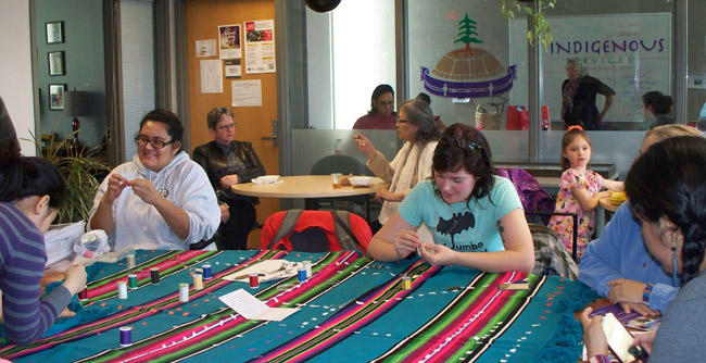 Tanaya Winder led a sewing session at the Indigenous Studies Department.  The blanket holds earrings representing the murdered and missing indigenous women in Canada.