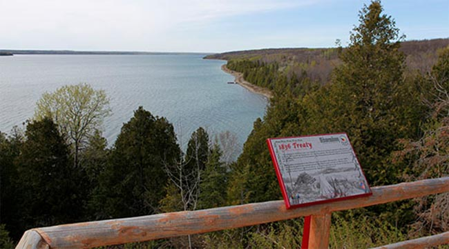 The 1836 Bond Head Treaty plaque commemorating the designation of Manitoulin Island as Indian territory is located at Buzwah on Manitowaning Bay.