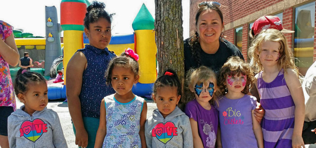 Kris Noakes, citizen of Nipissing First Nation, with the youngest members of Peel Aboriginal Network at their cultural celebration in Mississauga, June 6.