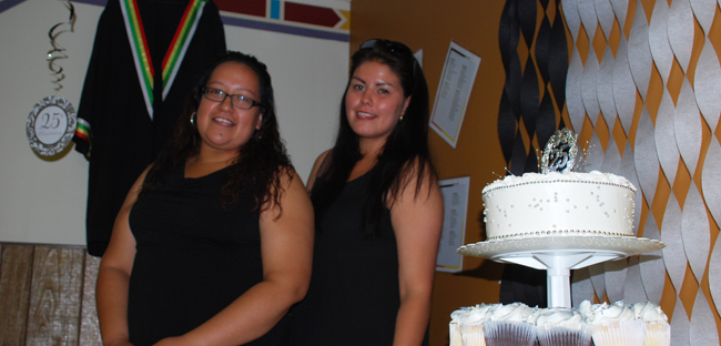 Graduates Morgan Stephens (Valedictorian Class of 2011) and Maggie Faries (Valedictorian Class of 2010) , celebrate the 25th anniversary reunion of N'Swakamok Friendship Centre's Native Alternative School on June 13, 2015.