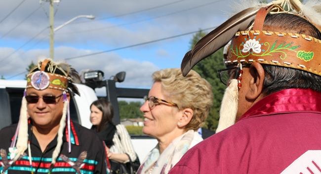 Anishinabek Nation Grand Council Chief Patrick Madahbee and Deputy Grand Council Chief Glen Hare greet Premier Kathleen Wynne in Fort William First Nation on Aug. 26 at the Anishinabek-Ontario Summit.