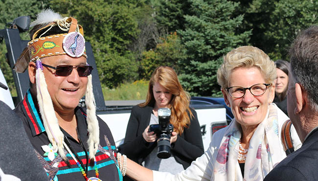 Anishinabek Nation Grand Council Chief Patrick Madahbee with Ontario Premier Kathleen Wynne at the Aug. 26 Anishinabek-Ontario Summit held in Fort William First Nation.    -- Photo by Marci Becking