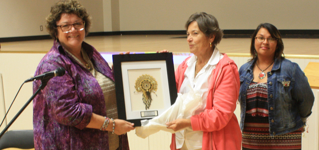 Dr. Jean Clinton receiving gift from Education Administrator, Karel Grant with SRFN Daycare Director Buffy Johnston.