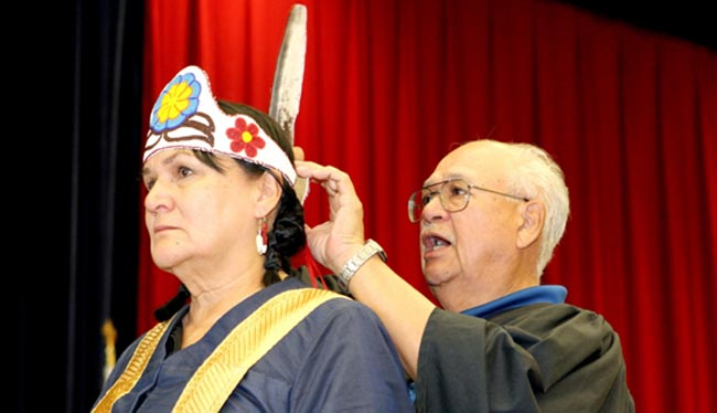 Weengushk Film Institute founder Shirley Cheechoo's brother Ben Cheechoo placed a beaded crown made by her late mother on her head during her Oct. 17 installation ceremony as Brock University's chancellor.
