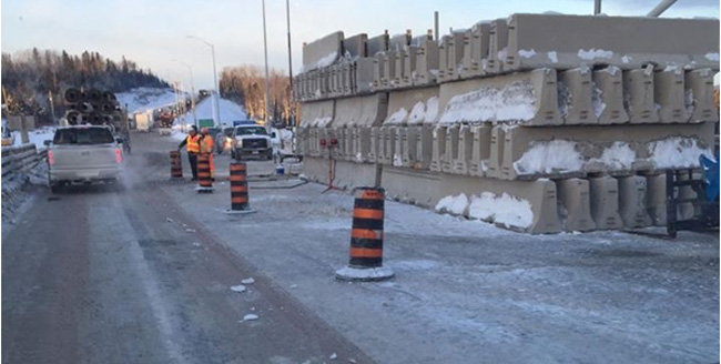 Traffic underway on the Nipigon River Bridge after about 100 concrete barriers, right, were placed on the bridge deck to bring it down to the level of the adjacent roadway on Jan. 11.