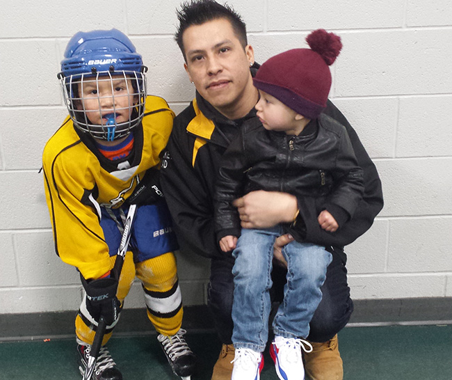 Bryan McGregor his son Brodie who played for the Wikwemikong Jr. Thunderbirds boys and Brodie's younger brother.