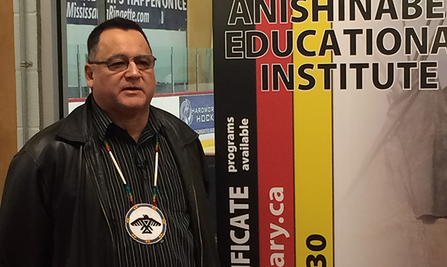 Grand Council Chief Patrick Madahbee stopped by the Anishinabek Educational Institute booth at the Little NHL.