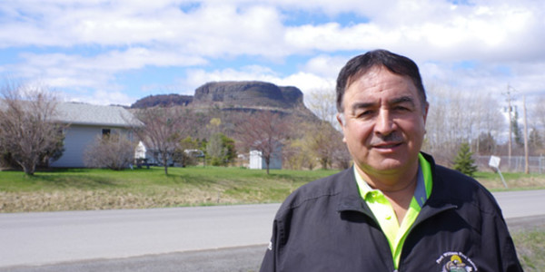 Fort William Chief Peter Collins stands outside the band office with Animikii-waajiw (Mt. McKay) in the background. He says it is important for residents and visitors to recognize the Indigenous territories and communities they are in.