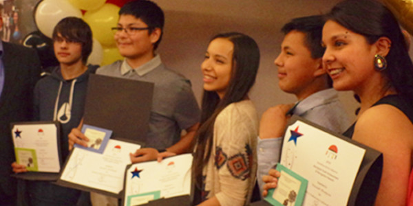 Pays Plat's Travis Jordan, far left  and Biinjitiwaabik Zaaging Anishinaabek's Winonah Thompson, far right, were among six recipients of the Sandra Kakeeway Cultural Award at the 12th Annual Northwestern Ontario Aboriginal Youth Achievement and Recognition Awards on May 5.