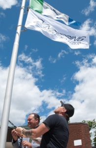 North Bay Mayor Al McDonald and Nipissing First Nation Chief Scott McLeod raising the Nipissing First Nation flag on National Aboriginal Day.