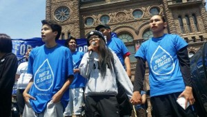 Grassy Narrows youth performing song on stage at Toronto rally on June 2.
