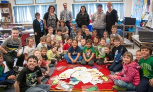 Niibin Nakogee, Grade 3 student with his brother, JK student Lance Sarazin, with students who penned messages of hope for Attawapiskat Youth.  Teachers who helped students take part are L to R: Carol-Anne Renton, Julie Crea, Principal Dan Seguin, Tasheena Sarazin (mother), Anna McLeod, Michelle McMartin.