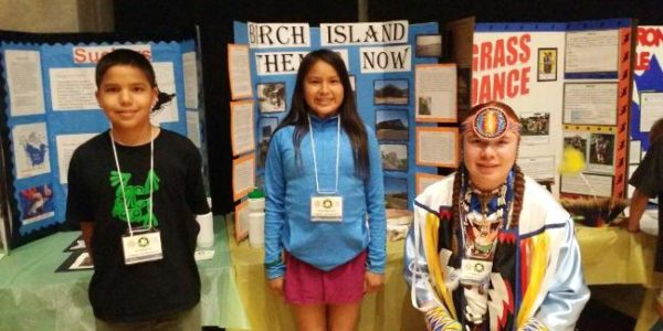Eli Paibomsai, Avery Sutherland, and Shade Kaiser, with their projects at the Provincial Heritage Fair, Toronto, June 11