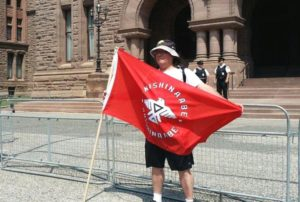 John Oskaboose Jacobs, citizen of Serpent River First Nation standing in support of Grassy Narrows First Nation at Queen's Park, July 7.