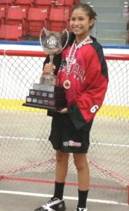Sidney Deleary holding the trophy