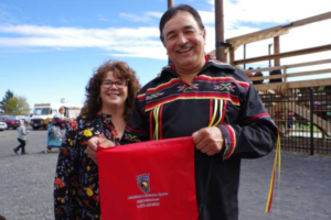 Fort William Chief Peter Collins and Councillor Michele Solomon with a Say Yes to AES bag at the Fort William Fall Pow Wow on Sept. 30. Collins looks forward to the creation of new education initiatives through AES.