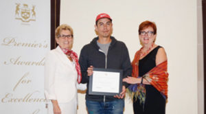 Fort William artist Christian Chapman was presented with the Emerging Artist of the Year award on Oct. 5 by Premier Kathleen Wynne and Eleanor McMahon, minister of Tourism, Culture and Sport. Photo credit: Sonia Cacoilo
