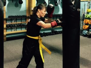 Jennifer Ashawasegai practicing on the heavy bag at Family Kickboxing in Sudbury.    Photo credit: Coach Ray Blais